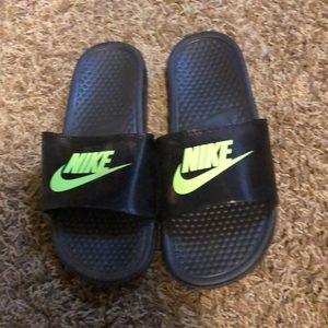Black with green Nike logo slip ons